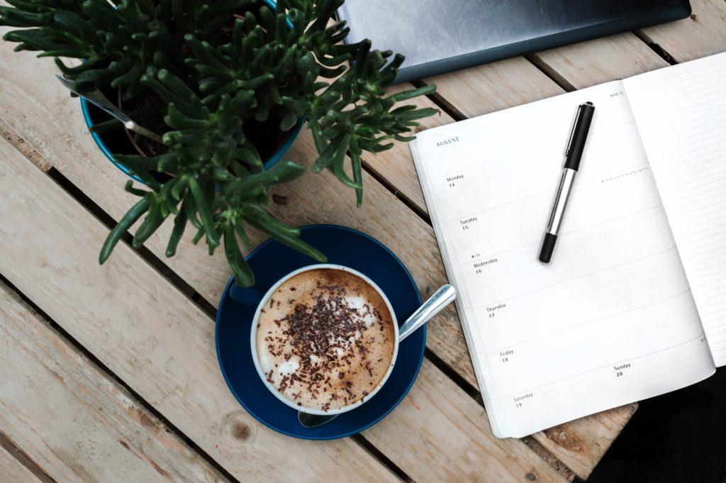 Planner, coffee, plant